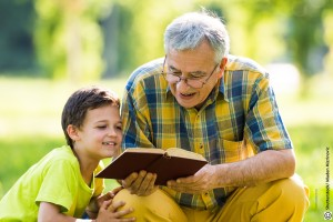 Older men reading with child _ Shutterstock picture